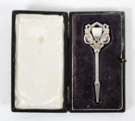 An unusual 19th century white metal key, possibly for a carriage, the pierced scrolled handle,