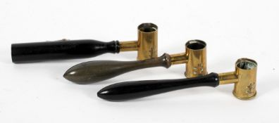 A set of three late 19th century brass and turned wood gun powder shot measures,