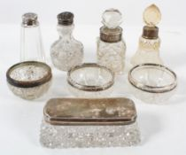 A collection of assorted silver topped and mounted glass items, including open salts,