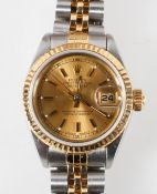 A mixed metal Rolex oyster perpetual datejust watch.
