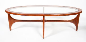 A 1960's vintage Stonehill teak wood oval coffee table with inset glass top