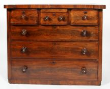 A Victorian mid 19th century chest of drawers with three short drawers above three long drawers,