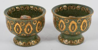 A pair of Bitossi for Rosenthal pottery green glazed candle sticks, circa 1960,