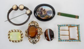 A collection of costume brooches and buckles of variable designs.