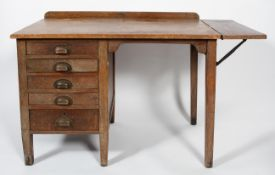 An oak desk, with five small drawers, extending leaf to the right hand side,