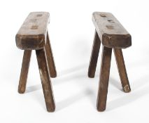 A pair of joint oak three-legged stands, 18th/19th century, perhaps coffin stands,