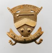 A yellow metal medal brooch awarded for golf.