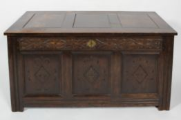 A Victorian oak coffer, late 19th century, of panelled construction,