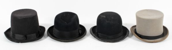 A Moss Bros grey top hat, Size 7 1/8; another top hat,
