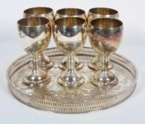 A Sheffield plated circular tray and six plated wine goblets, the tray stamped Alpha Plate,