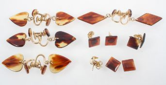 A collection of costume earrings in the style of tortoise shell.
