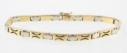 A yellow and white metal linked bracelet. Push in clasp with figure of eight safety catch.