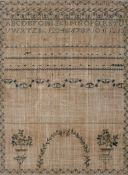 A Georgian sampler, by Sarah Johnson, worked with alphabets, numbers and rhyme above flowers,