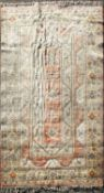 A large wool carpet, decorated with geometric reserves on a coral beige,
