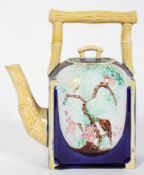A late 19th century aesthetic movement Majolica teapot with simulated bamboo handle and spout,