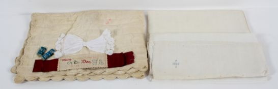 A collection of linen, comprising : two table cloths,