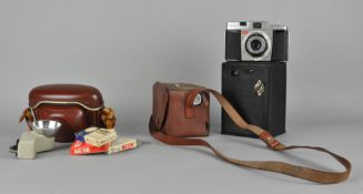 A collection of assorted cameras, including a Kodak Brownie,