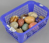 A collection of stone eggs of varying sizes and materials,