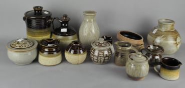 An assortment of mixed Studio pottery, including lidded dishes,