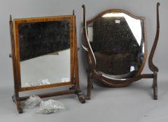 A mahogany shield shaped mirror,