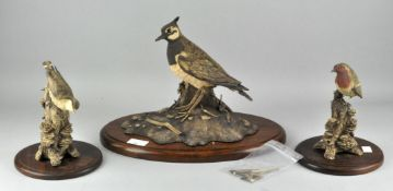 Three Linda Heaton Harris certificated earthenware figures of birds : Robin, Nuthatch and Lapwing,
