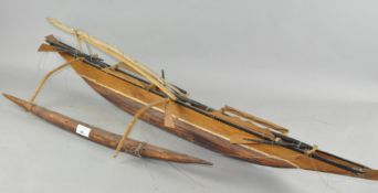 A scratch built wooden model of a boat,