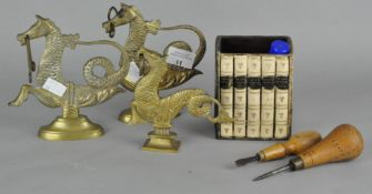 A group of three brass models of dragons, largest 15cm high,