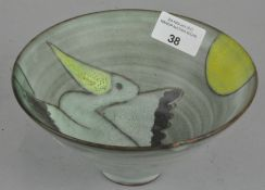 An art pottery bowl with pelican design to inside,