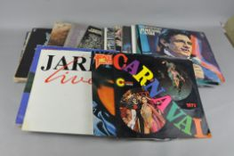 A group of vinyl records, including Fairport Convention, Carole King, The Band, Eagles,