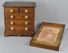 A table top apprentice chest of drawers, two short and three long drawers,