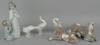 A collection of LLadro figures, including a horse, donkey and geese,
