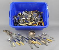 A large assortment of silver plate and other flatware,