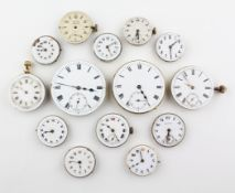A collection of fourteen mechanical watch movements with dials attached.