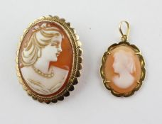A yellow metal oval carved cameo brooch set within a fancy edge mount.