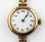 A yellow metal wristwatch. Circular white 25.0mm dial with numerical markings. Manual wind movement.