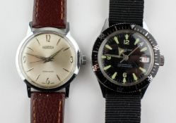 A stainless steel Roamer wristwatch, manual wind movement, brown leather strap.