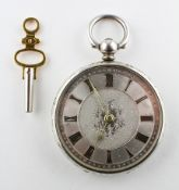 An open face pocket watch. Circular silver dial with roman numerals and floral engraving.