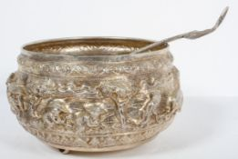 An Asian white metal punch bowl, heavily repousse and chased,
