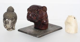 A cast model of a bulldog head on silvered metal base, 6cm high, together with two parasol handles,