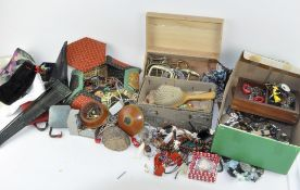 An assortment of costume jewellery, including wristwatches,