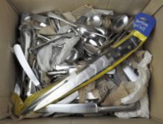 A group of stainless steel flatware
