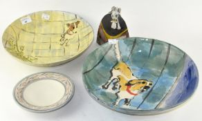 Two contemporary bowls, painted with dogs,