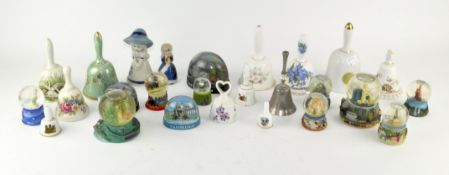 A collection of assorted ceramic bells and snow globes
