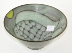An Art pottery bowl with abstract fish decorated to the inside, marked to base 'TF', 16.