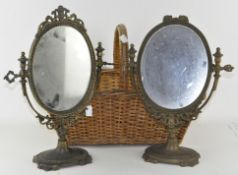 Two similar metal toilet mirrors, on stands,