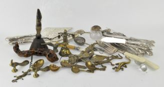A collection of assorted metalware, including silver plated flatware, deer foot handled bell,