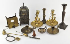 A collection of assorted items, including a brass dome shaped clock,