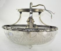 An ornate silver plate mounted pressed glass ceiling light,