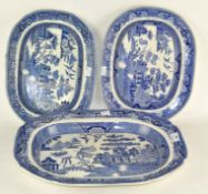 Three blue and white ceramic meat platters, one marked 'Staffordshire Stone china'.