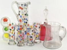 A selection of glassware, including large pouring glass with polka dot decoration,